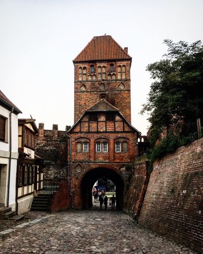 Building Exterior Architecture Built Structure Outdoors The Way Forward Real People Day Sky Men One Person People Tangermünde Sachsen-Anhalt Architecture Architecture_collection History Historical Building Historic Architecturelovers Romantic Bricks Brick Building Brick Wall Old Buildings Old Town