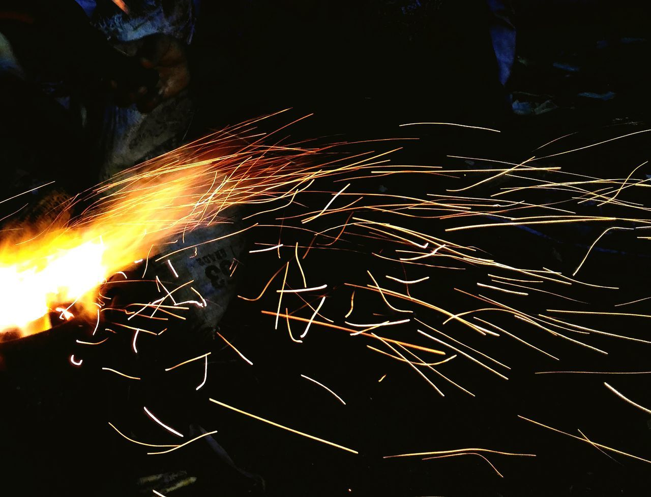 sparks, glowing, long exposure, industry, no people, metal, motion, heat - temperature, night, indoors, metal industry, close-up, technology, manufacturing equipment