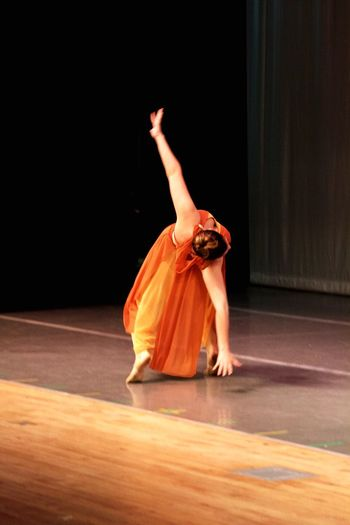 Full length of woman dancing on stage