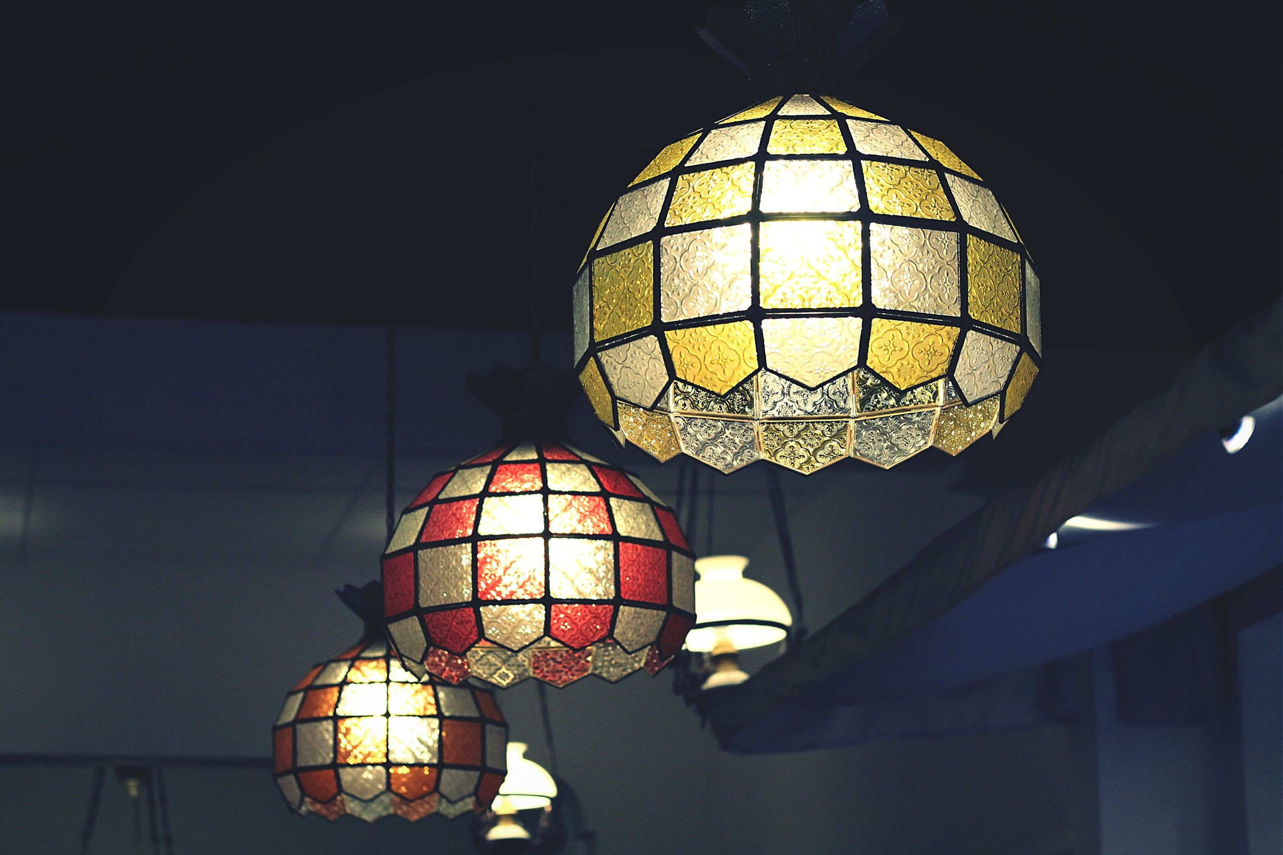 illuminated, lighting equipment, indoors, ceiling, hanging, low angle view, night, decoration, light bulb, electric light, electricity, lantern, electric lamp, chandelier, glowing, light - natural phenomenon, built structure, light, lamp, decor