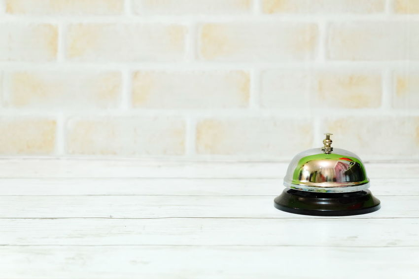 Ring bell on a table. Copy space for text or logo. Ring Bell Lobby Front Desk Front Counter Hotel Motel Ring Ting Metal Object Backgrounds Copy Space No People Indoors  Day Close-up