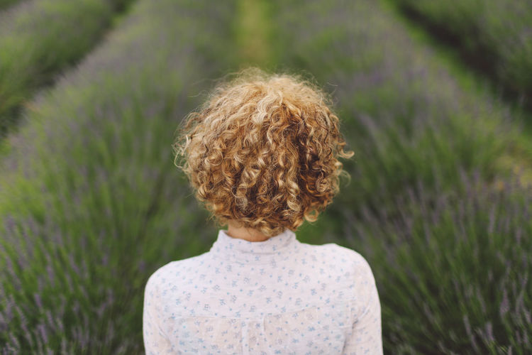 Beauty In Nature Blonde Casual Clothing Close-up Curly Hair Day Focus On Foreground Girl Grass Grassy Growth Headshot Lavanda Lavander Lavander Flowers Lavanderfields Leisure Activity Lifestyles Nature Outdoors Part Of Plant Selective Focus Summer Breathing Space