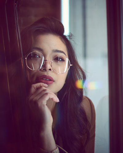 Portrait Of Young Woman Seen Through Glass