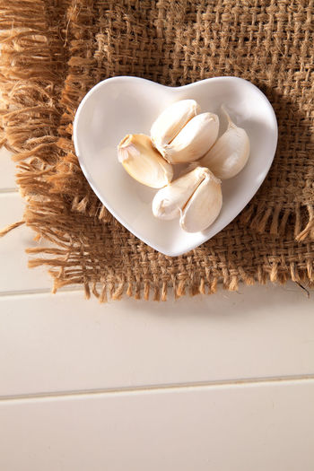 Close-up of garlic on burlap