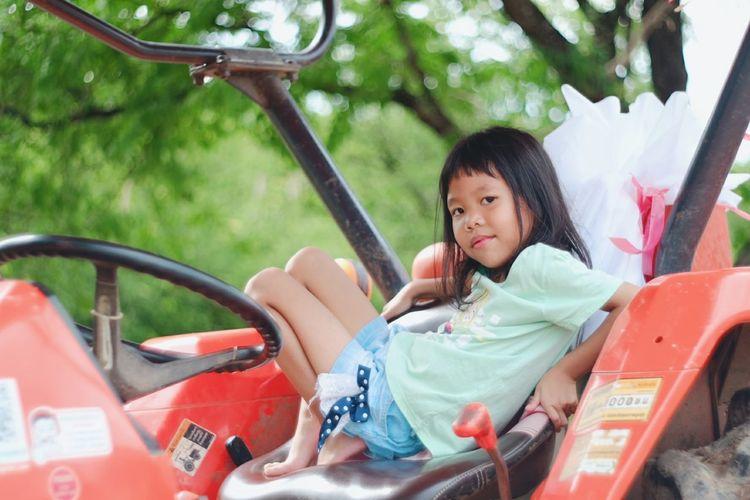Portrait Of Girl Sitting In Truck