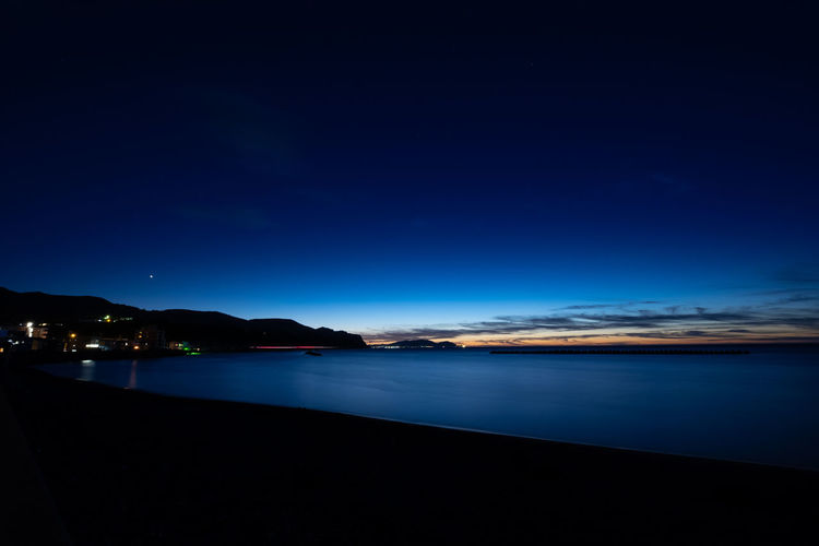 Beach Beauty In Nature Blue Cloud - Sky Copy Space Dark Dusk Illuminated Land Mountain Nature Night No People Outdoors Scenics - Nature Sea Sky Tranquil Scene Tranquility Water