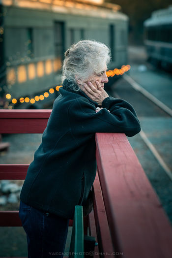 One Person Senior Adult Built Structure Focus On Foreground Gray Hair Portrait Of A Woman Portrait Photography Portraits Streetphotography Noir Senior Women Lifestyles Real People Train Station Train Tracks
