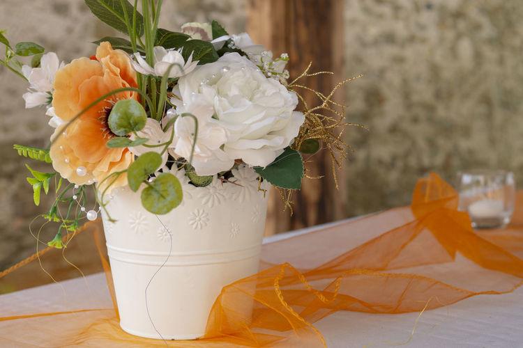 Close-up of white rose flower vase on table
