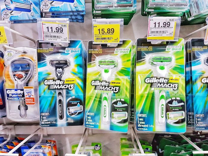 Gilette products hanging on at retail shop. No People Gilette Shave Clean Man Health Lifestyles Shop Shoppingmall Healthy Business Store Shelf Razor Beard Cleaning Men Utility Style Morning Buy Money Sale Selling Bathroom