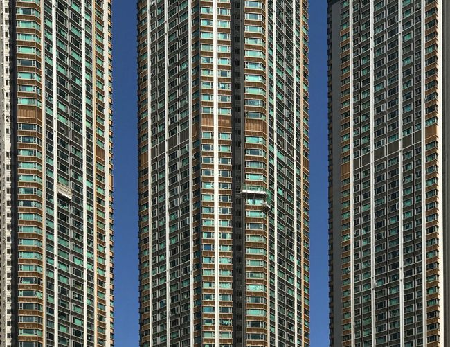 Skyscraper Architecture Modern Building Exterior Built Structure Window Day Low Angle View Backgrounds City Sky Apartment No People Cityscape Clear Sky Outdoors Urban Skyline Urbanperspectiives Hong Kong Lifestyles The Graphic City The Architect - 2018 EyeEm Awards The Architect - 2019 EyeEm Awards The Mobile Photographer - 2019 EyeEm Awards