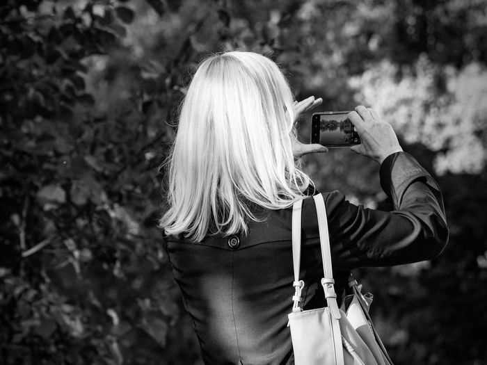 Woman photographing with phone
