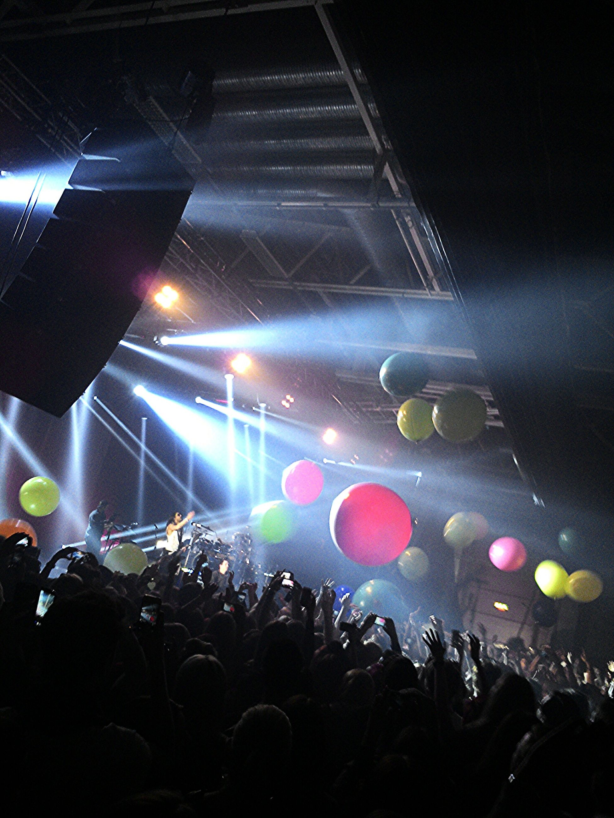 illuminated, arts culture and entertainment, large group of people, crowd, nightlife, music, event, person, night, performance, enjoyment, leisure activity, celebration, youth culture, fun, men, lifestyles, stage - performance space, concert