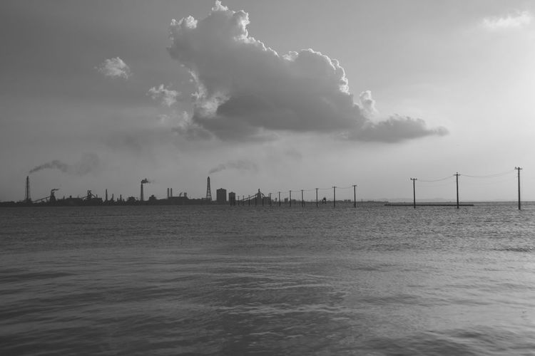 Cloud - Sky Sky Water Sea Architecture Built Structure Factory Waterfront Industry Environment Building Exterior Nature Smoke Stack No People Outdoors Day Fuel And Power Generation Pollution Landscape Air Pollution Atmospheric Power In Nature Ecosystem