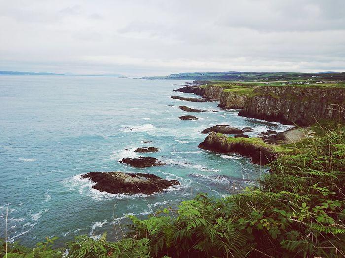 Dunseverick coastline Norther Ireland Ocean Cliff Rugged Irish Coast Waves Crashing Wild Seascape Beauty In Nature Sea And Sky Peace Tranquility Coastline Northern Ireland Walks Cliffside Blue Waves Sand Sky Horizon Over Water Landscape Cloud - Sky