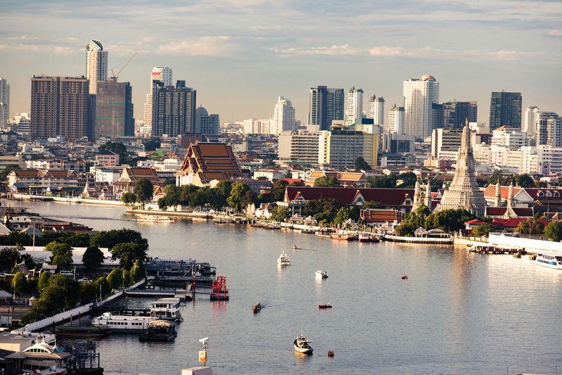 Curve of chao phraya river near wat arun in morning, landmark of bangkok, urban, city