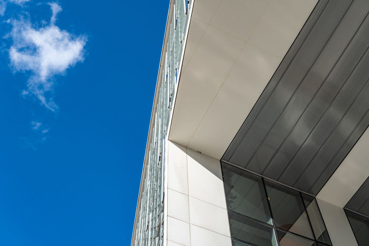 Architecture Building Exterior Built Structure Low Angle View Building City Modern Office Office Building Exterior Day No People Window Outdoors Glass - Material Modern Architecture Architectural Feature Architecturelovers Part Of Sky Cloud - Sky Nature Sunlight Cloud Blue Pattern Directly Below