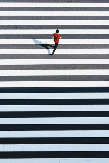 Man standing on zebra crossing