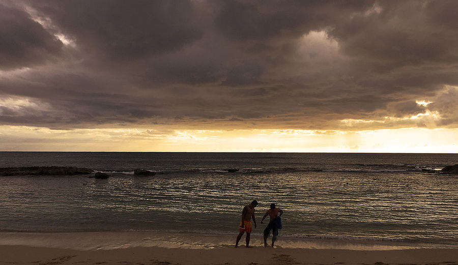 Two fisherman end their day along the north shore of Oahu as the sun sets. The fishermen were part of a demonstration of traditional fishing techniques before a luau at Paradise Cove Beauty In Nature Dramatic Sky Hawaii Life Honolulu  Horizon Over Water Ko Olina Oahu Sea Sunset Tranquil Scene