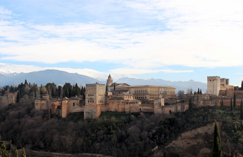 Palace of charles v by mountains against sky