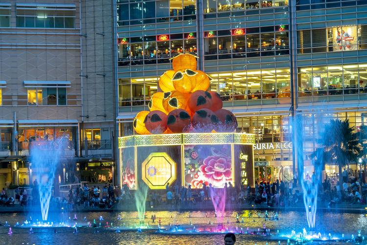Sunset at Petronas Twin Towers KLCC, Kuala Lumpur Building Exterior Architecture Built Structure City Illuminated Representation Reflection No People Store Window Water Building Human Representation Transparent Glass - Material Motion Art And Craft Office Building Exterior