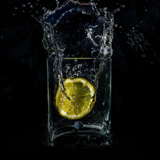 Close-up of drink in water against black background