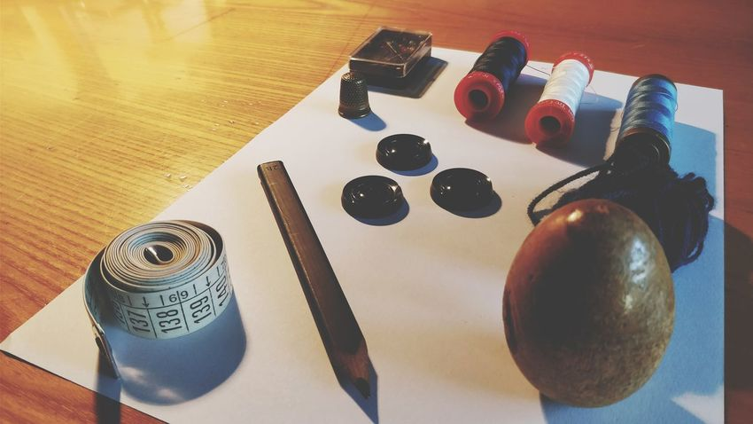 All you need is there. EyeEm Selects Table Wood - Material High Angle View Close-up Sewing Sew Sheet Thimble Thread Twine Handworking Buttons
