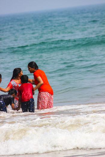 Siblings enjoying at beach