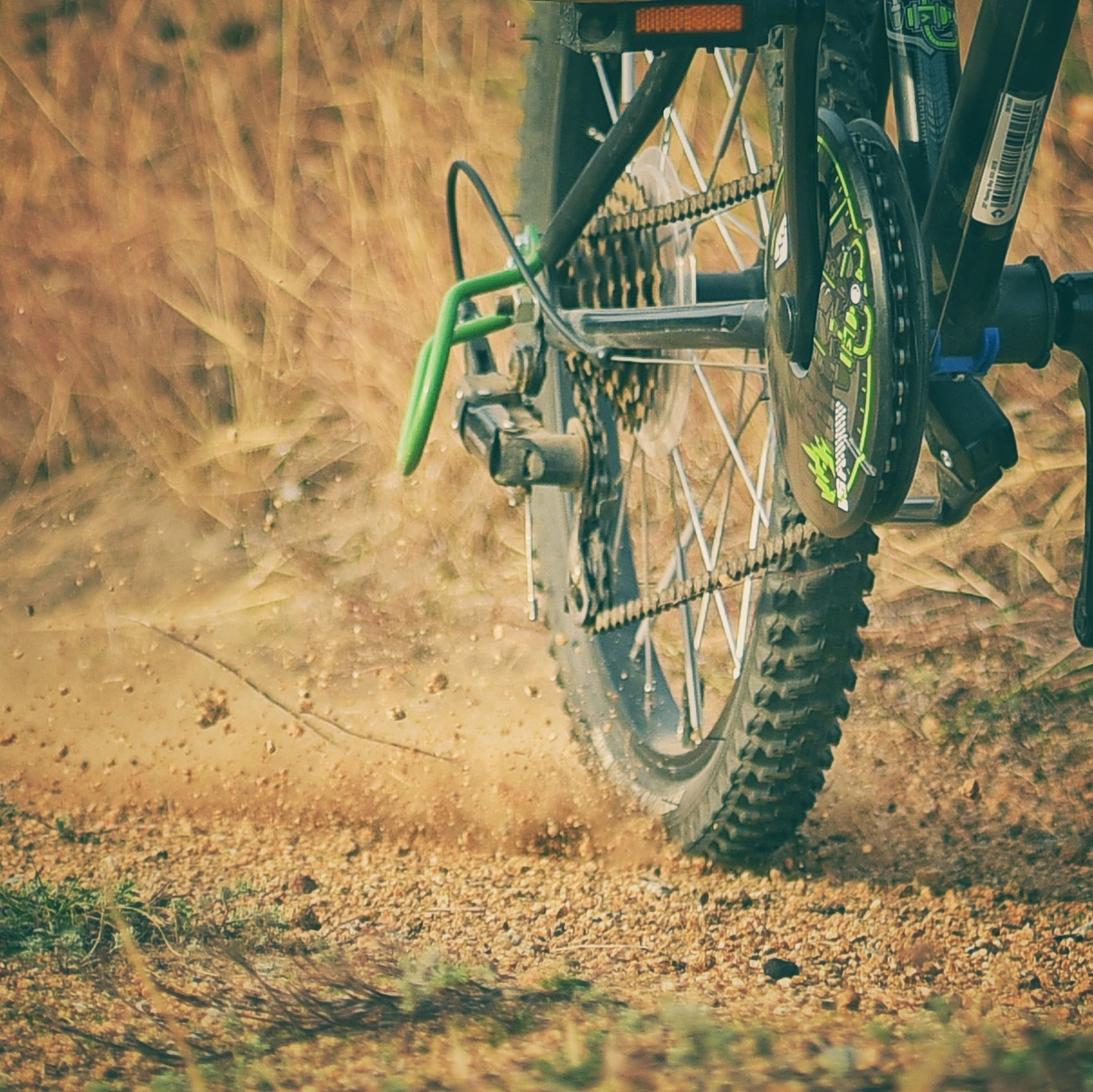 transportation, land vehicle, mode of transportation, wheel, day, land, field, nature, outdoors, no people, stationary, dirt road, bicycle, dirt, motorcycle, tire, travel, plant, road, selective focus