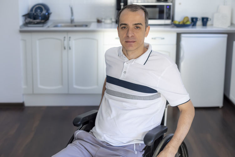Portrait of mid adult man sitting at home
