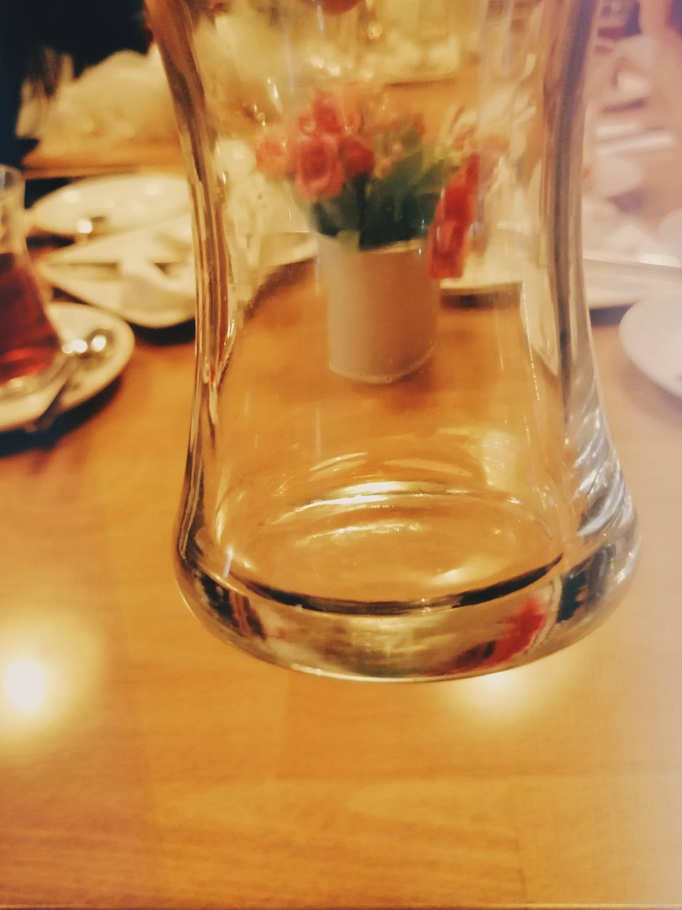 CLOSE-UP OF GLASS OF JUICE