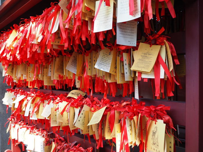 Fortune papers hanging outside temple