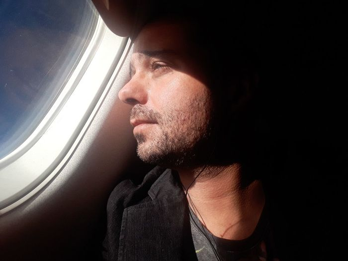 Close-Up Of Passenger Sitting In Airplane