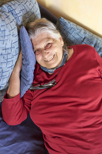 Aged Woman Woman Aged Aging Bed Casual Clothing Close-up Day Grandmother Home Interior Indoors  Leisure Activity Looking At Camera Lying Down One Person People Real People Senior Senior Adult Senior Woman Senior Women Young Adult