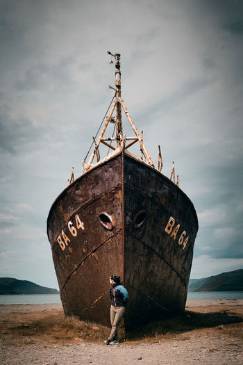 Low angle view of man on boat against sky