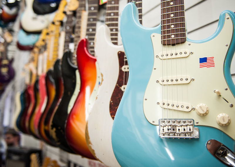 Guitar exposed in store showroom Chords Electric Guitar Guitar Body In A Row Many Music Musical Instrument Part Of Selective Focus Shop Showroom Sound Store String Stringed Instrument Wooden