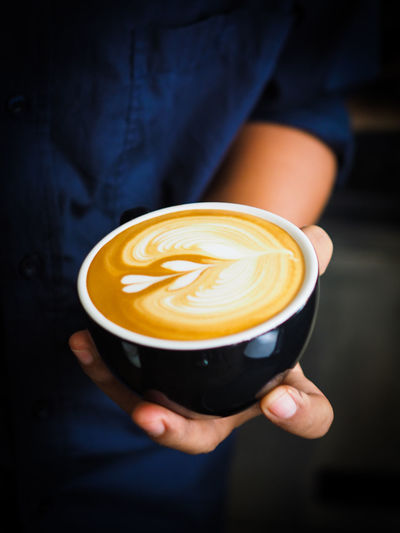 Cafe Cappuccino Close-up Coffee - Drink Coffee Cup Day Drink Focus On Foreground Food And Drink Freshness Froth Art Frothy Drink Holding Human Hand Indoors  Latte One Person People Real People Refreshment Service