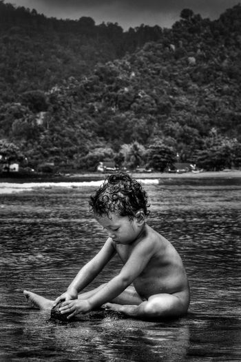 Young Child Sitting In Water