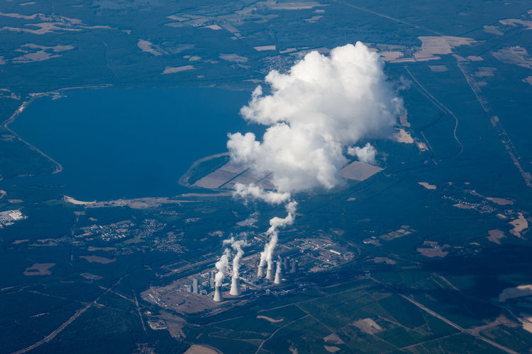 Aerial view of smoke emitting from cooling towers