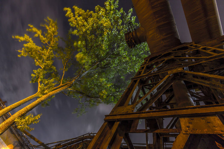 Architecture Built Structure City Coalmine Day Dolni Oblast Vitkovice Futuristic Gold Colored Iluminated Industry In City Industry Vs Nature Long Exposure Low Angle View Night Sky No People Outdoors Pipeline Sky Steel Factory Vitokovice