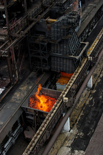 NLMK, Altai coke plant, Russia, metallurgy, wewalka coke from ovens Burning Day Fire - Natural Phenomenon Flame Glowing High Angle View NLMK, Altai Coke Plant, Russia, Metallurgy, Wewalka Coke From Ovens No People Outdoors Railroad Track Railway Track Transportation