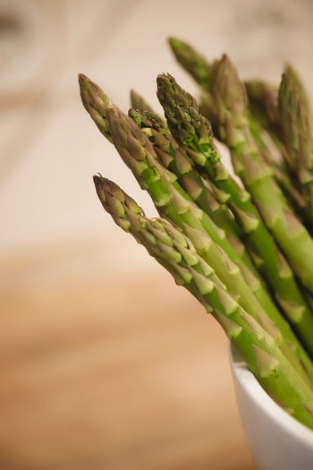 Close-up of green asparagus on table