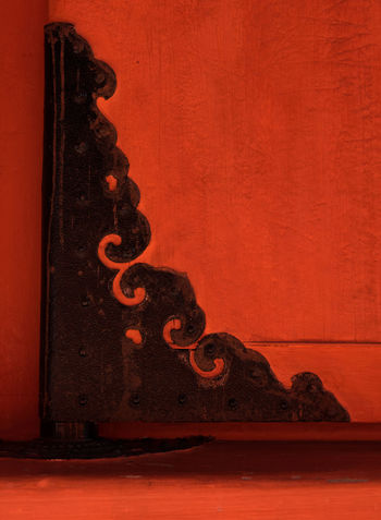 A black, decorative hinge on the red wooden door of a temple building in Japan. Close-up of the corner. Black Black On Red Bold Colors Close-up Corner Door Hinge Japan Japanese  Red