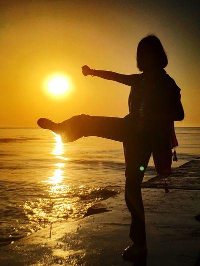 Sunset Silhouette Water Sea Real People Sky Beach