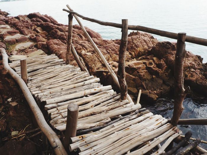 High angle view of wooden logs on beach