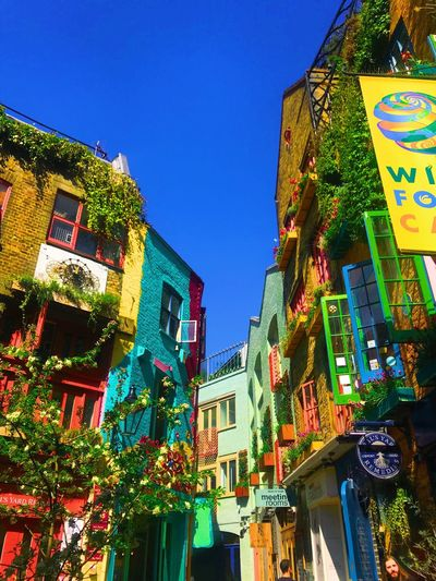 one of my favorite hideouts in London just sit and enjoy the color Seven Dials Neal's Yard London Colorful Building Exterior Built Structure Architecture Sky Low Angle View Building Clear Sky