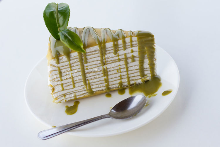 Green tea crape cake on white background Crape Cake On White Background Close-up Dessert Food Food And Drink Freshness Green Tea Green Tea Crape Cake Green Tea Latte Indulgence Ready-to-eat Serving Size Studio Shot Temptation White Background