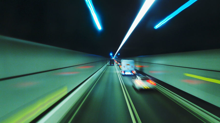 Blurred view of cars driving in tunnel