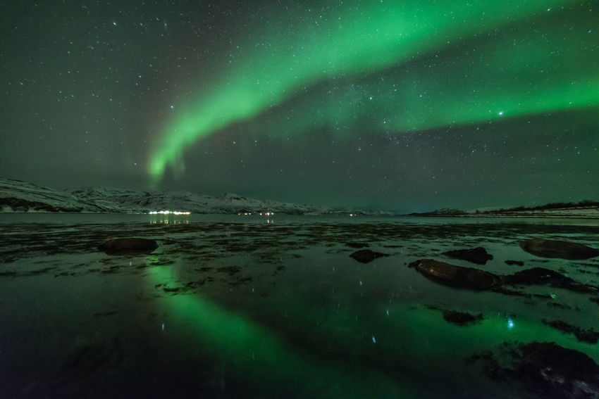 Northern lights with a beautiful reflection in Dafjord Aurora Borealis Northern Lights Norway Arctic Astronomy Aurora Polaris Beauty In Nature Galaxy Green Color Illuminated Mountain Natural Phenomenon Nature Night No People Outdoors Reflection Scenics Sea Sky Star - Space Tranquil Scene Tranquility Water Winter