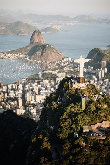 Christ the redeemer Architecture Sea Water Building Exterior Nature Built Structure High Angle View Sky Building Mountain Travel Destinations Land Day Beach Tourism Sunlight City Cityscape Travel No People