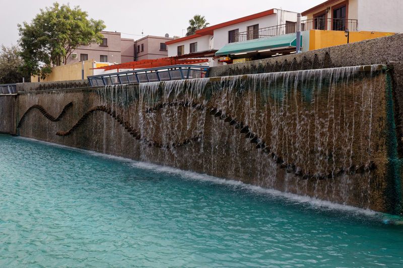 Beautiful fountain on the side of the river Architecture Blue Building Exterior Built Structure City Day Fountain Mexico Motion No People Outdoors River River View Sky Splashing Travel Destinations Water